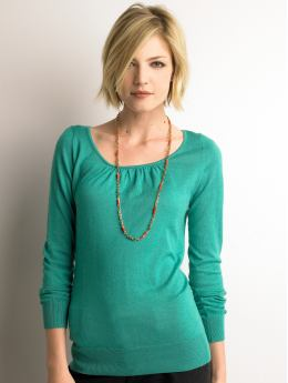 This teal scoopneck sweater frames the face but is a modest choice